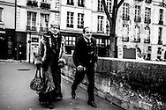 March 2015. Ile de Saint Louis, Paris. Couple walking by the streets.