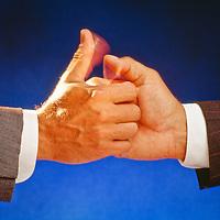 thumb wrestling executive hands