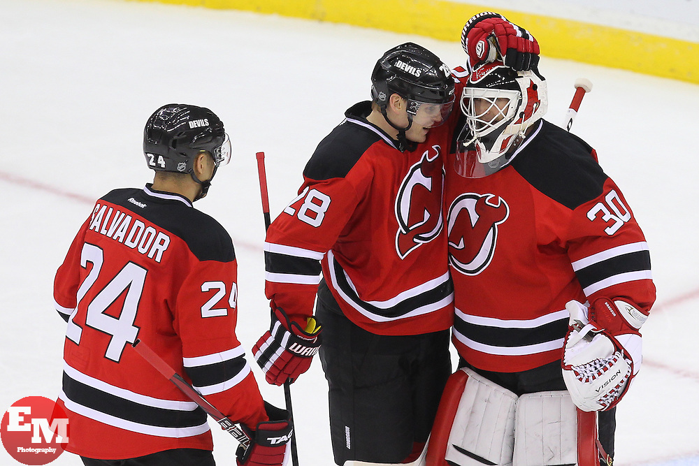 Feb 7, 2013; Newark, NJ, USA; New Jersey Devils defenseman Bryce Salvador (24) and New Jersey Devils defenseman Anton Volchenkov (28) congratulate New Jersey Devils goalie Martin Brodeur (30) after defeating the Tampa Bay Lightning 4-2 at the Prudential Center.