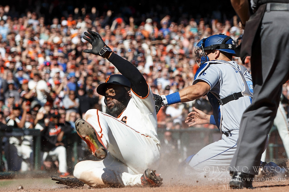 SAN FRANCISCO, CA - OCTOBER 02: Denard Span #2 of the San Francisco Giants slides into home plate to score a run ahead of a tag from Yasmani Grandal #9 of the Los Angeles Dodgers during the eighth inning at AT&T Park on October 2, 2016 in San Francisco, California. The San Francisco Giants defeated the Los Angeles Dodgers 7-1. (Photo by Jason O. Watson/Getty Images) *** Local Caption *** Denard Span; Yasmani Grandal