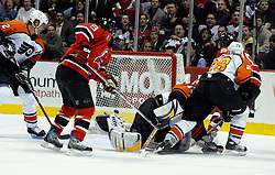 Mar 30, 2007; East Rutherford, NJ, USA; New Jersey Devils center Travis Zajac (19) scores during the second period at Continental Airlines Arena in East Rutherford, NJ.