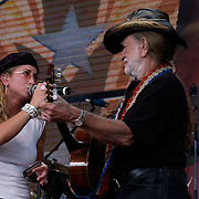 September 7, 2003; WILLIE NELSON with HEIDI NEWFIELD of TRICK PONY performing at Farm Aid, 2003, in Columbus, Ohio. Photo by Bryan Rinnert/3Sight Photography212