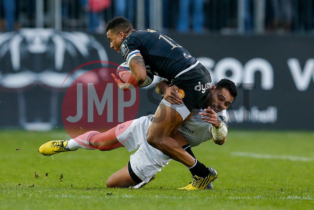 Bath Full Back Anthony Watson is tackled by Leinster Outside Centre Ben Te'o - Mandatory byline: Rogan Thomson/JMP - 21/11/2015 - RUGBY UNION - The Recreation Ground - Bath, England - Bath Rugby v Leinster Rugby - European Rugby Champions Cup.