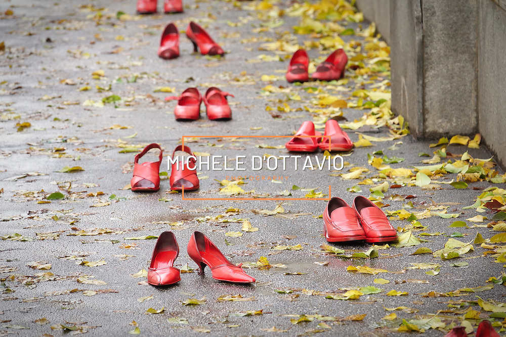 Turin, Italy - November 25, 2016: red shoes united against violence on women  Scarpe rosse: uniti contro la violenza sulle donne