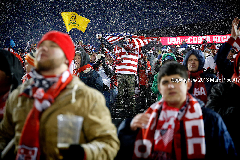 SHOT 3/22/13 6:24:04 PM - United States soccer fans cheer the team's effort against Costa Rica during their World Cup qualifying game at Dick's Sporting Goods Park in Commerce City, Co. on Friday March 22, 2013. The U.S. won the game 1-0 in a spring blizzard that blanketed the pitch and fans in the stadium in snow. (Photo by Marc Piscotty / © 2013).