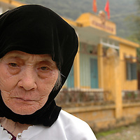 Woman mourns deceased relative in Cat Ba island Halong Bay, Vietnam.
