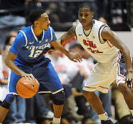"Kentucky's Ryan Harrow (12) works against Mississippi's Jarvis Summers (32) at the C.M. ""Tad"" Smith Coliseum on Tuesday, January 29, 2013. Kentucky won 87-74. (AP Photo/Oxford Eagle, Bruce Newman).."