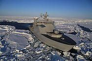 Norwegian coast guard icebreaker, K/V Svalbard, creates  pathway in frozen Arctic Ocean at 83° north latitude far north of Svalbard, Norway.