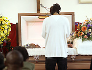 Omari Shakur views Tyrik Omar Legette's body during his funeral at the House of Joy Church in the City of Newburgh, NY on Friday, May 8, 2009. Legette is the 34 year old man who was stabbed to death on Lander Street by a group of youths on April 30th.