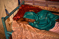 A woman rests at her home in DJabal refugee camp near Goz Beida, Chad.