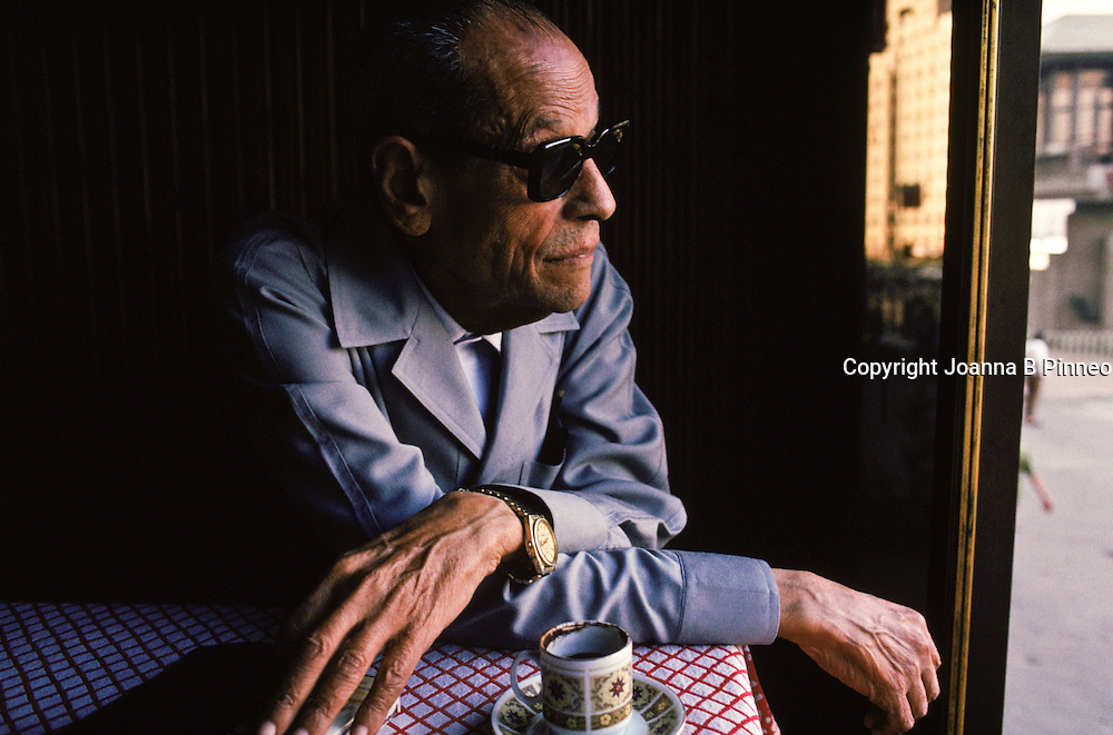 Naguib Mahfouz at the Ali Baba Cafe in Cairo, Egypt. Mahfouz  won the 1988 Nobel Prize in literature, the first writer in Arabic to be so honored. Mahfouz is famous for capturing in fiction, the settings and everyday lives of Cairo people. At times, various governments banned his books. Ali Baba Cafe in Cairo, Egypt. He was 78 in 1990.