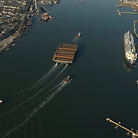 Aerial photographs of the Tugboat, Ranger (Crowley Maritime) pulling 17 barges through the New York Harbor<br /> 3/25/2009. Aerial view of Nautical Vessel Aerial view of Nautical Vessel Aerial view of Nautical Vessel