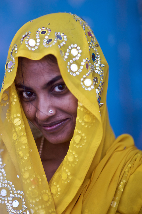 This woman was a pilgrim to Varanasi.  On a rainy morning she stopped against a blue backdrop and allowed me to make a quick picture before she disappeared back into the crowds.