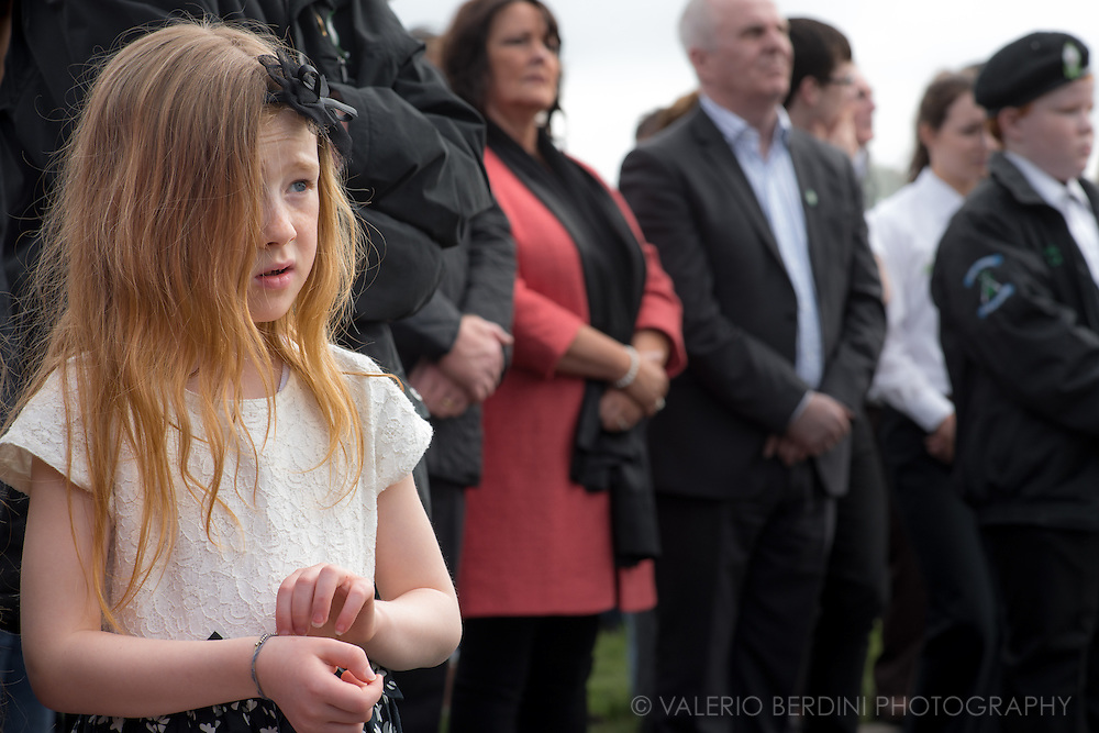 A young girl listens to a remembrance ceremony held in the Derry Cemetery in memory of the dead on the Republican front during the Troubles. Many people in Derry have some members of the family affected by the clashes between loyalists and unionists which caused thousands of deaths in the regions, on both fronts, between the 60s and the 90s.