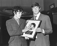 """Donovan 1967 with producer Mickie Most and """"Sunshine Superman US Gold Disc.© Chris Walter."""