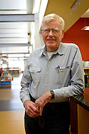 Professor Emeritus of Political Science George Drake poses for a portrait inside the Drake Community Library in Grinnell on Wednesday afternoon.<br />