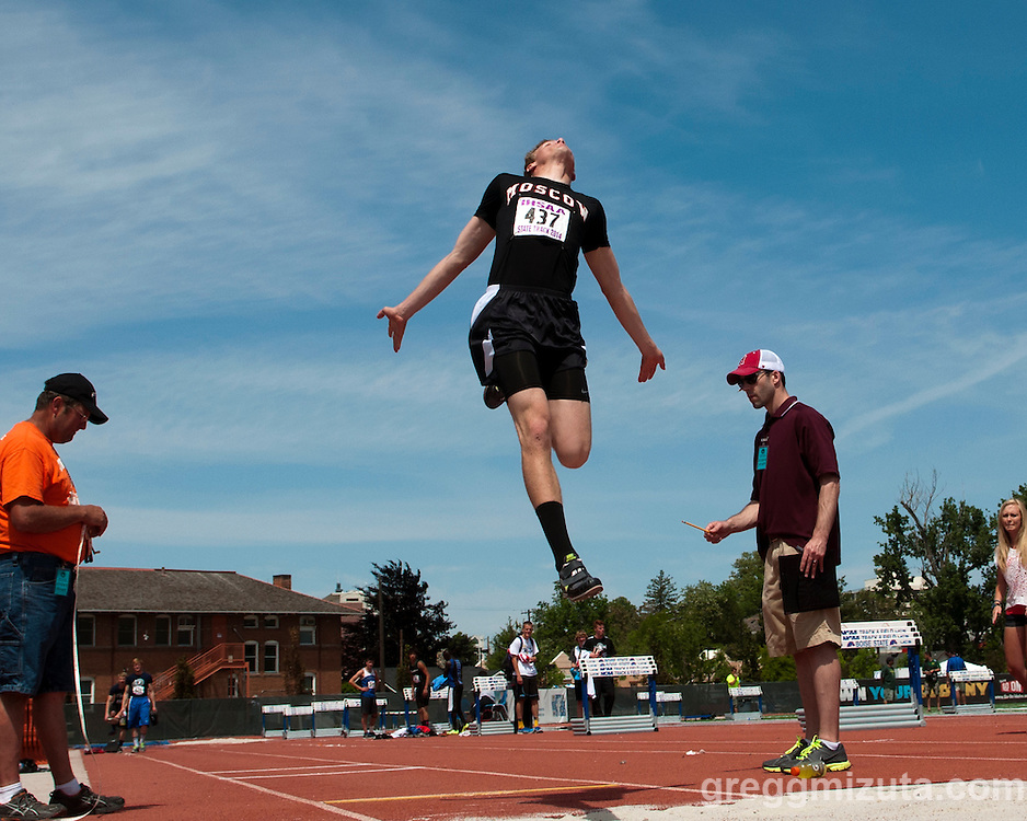 Moscow senior Alex Lewis long jumps during the Idaho 4A State Track & Field Championships at Dona Larsen Park, Boise, Idaho on May 17, 2014. Lewis finished first with a jump of 22-06.00.