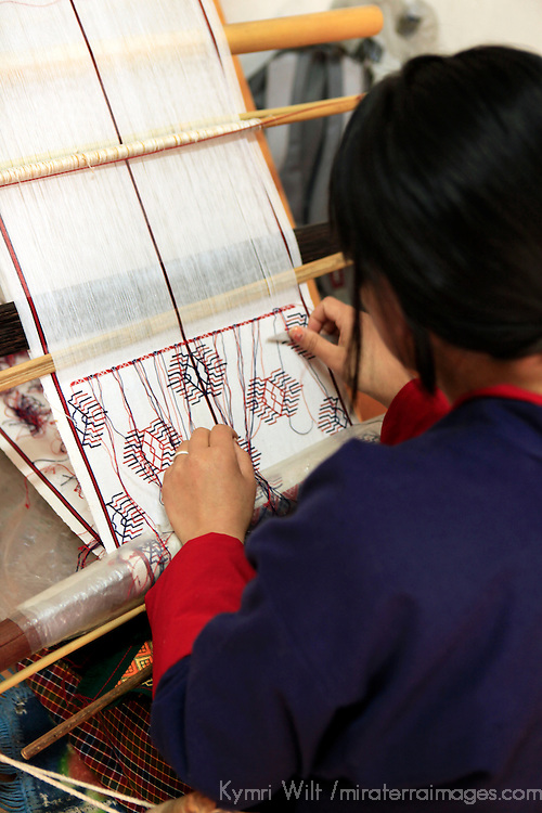 Asia, Bhutan, Thimpu. Weaving student at the National Institute for Zorig Chusum, or traditional arts and crafts.