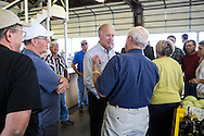 Vice President Joe Biden talks with staff and patrons during an unannounced stop at Schmidt's Farmer's Market during a two-day campaign swing through Iowa on Monday, September 17, 2012 in Muscatine, IA.