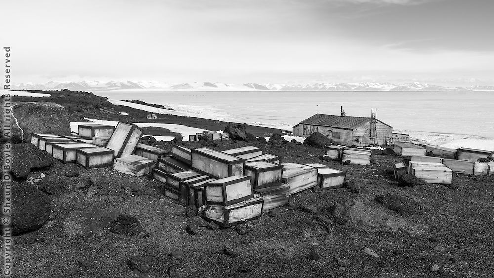 Stores on the ramp above the hut. Royal Society Range on distant shore of McMurdo Sound.