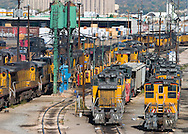 The engine servicing tracks at North Yard in Denver, CO are jammed with Union Pacific locomotives awaiting duty.