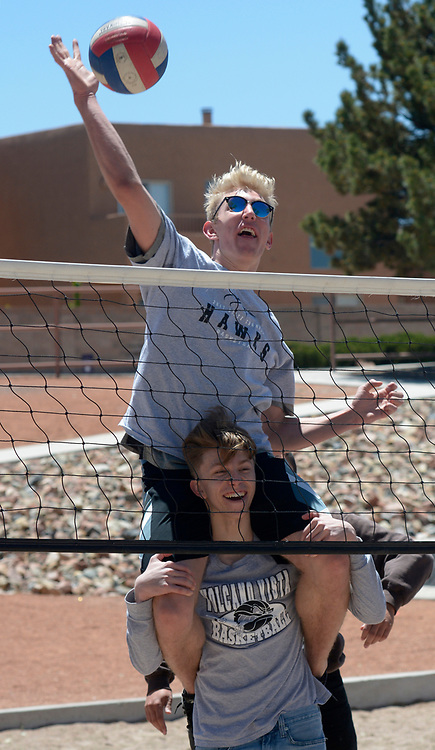 gbs043017g/RIO-WEST -- Volcano Vista High School basketball teammates, Josh Parmenter, top, and Kellen Wilson try an on the shoulders approach to a game of volleyball during the Day in Paradise celebration in Paradise Park on Sunday, April 30, 2017. (Greg Sorber/Albuquerque Journal)