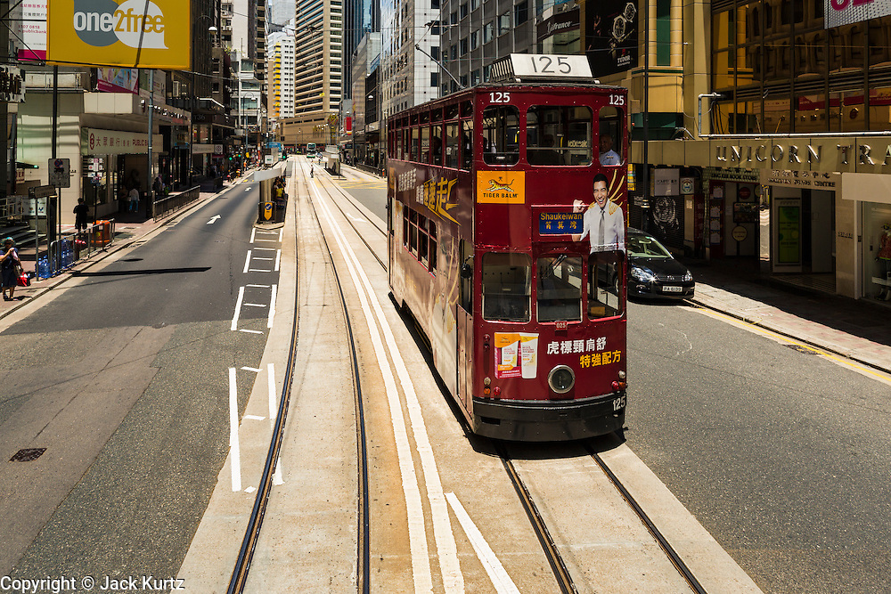 11 AUGUST 2013 - HONG KONG: A tram in the Central Business District of Hong Kong. Hong Kong is one of the two Special Administrative Regions of the People's Republic of China, Macau is the other. It is situated on China's south coast and, enclosed by the Pearl River Delta and South China Sea, it is known for its skyline and deep natural harbour. Hong Kong is one of the most densely populated areas in the world, the  population is 93.6% ethnic Chinese and 6.4% from other groups. The Han Chinese majority originate mainly from the cities of Guangzhou and Taishan in the neighbouring Guangdong province.      PHOTO BY JACK KURTZ