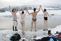 Members of the fledgling Jackson Hole Polar Bear Swim Club, from left, Peter Keenan, Liza Beance, Mark Holloway and Katie Wilson join hands and give out a yell before taking a Valentine's Day dip in the Snake River. Holloway hopes to recruit more dunkers into the club, citing the activity's invigorating benefits.