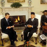 U.S. President Ronald Reagan meets with Indonesian President Suharto in the White House Oval Office in October 1982.