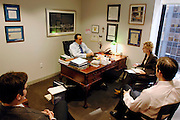 Star strategist Jason Trennert at his office in Manhattan,  New York City, 2007.Strategas Research Partners, LLC...from left to right:..Donald J. Rissmiller (Partner/Chief Economist).Jason DeSenaTrennert (Managing Partner/Chief Investment Strategist).Journalist Cornelia Heins.Nicholas Bohnsack (Operating Partner/Investment Strategist)..Strategas Research Partners, LLC is a leading investment strategy, macro-economic, and policy research firm focused on providing timely and insightful research on the global equity and debt markets to the institutional investment community. The Firm was co-founded by Jason Trennert, Nicholas Bohnsack and Don Rissmiller, and employs research analysts and institutional salesmen at offices in New York and Washington DC..