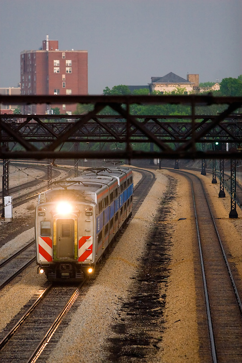 Speeding towards its Chicago station stop, a Metra Electric train is racing a fast moving rainstorm through the south side of the city.