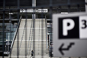 A woman is seen passing by behind access gate H at Stade de France sports stadium three weeks after the terror attacks of November 13, 2015.<br /> <br /> &copy;peter-juelich.com