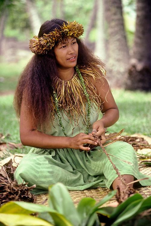 Woman making sandals from ti leaves at annual cultural festival; Pu'uhonua O Honaunau National Historical Park, South Kona, Island of Hawaii.