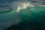 Massive waves crash against the rocks along the coast at Hanga Roa, Easter Island, Chile