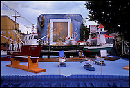 GLOUCESTER, MA- JUNE 28, 2003:  A float with replicas of the fishing boats from Gloucester that have sunk at sea are displayed during the annual celebration paying homage to St. Peter, the patron saint of fishermen in Gloucester, MA. The festa takes place on the weekend closest to the Feast Day of St. Peter, June 29. .(Photo by Robert Falcetti) . .