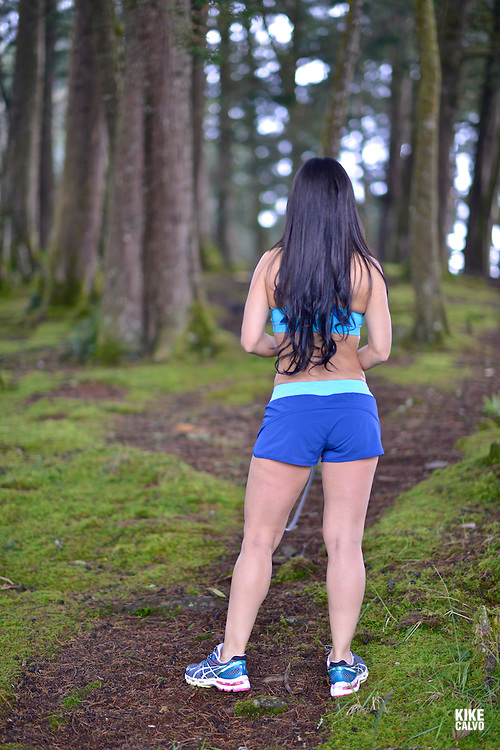 Hispanic woman in her exercising fitness workout in a forest.   May 29, 2014. (Kike Calvo via AP Images)