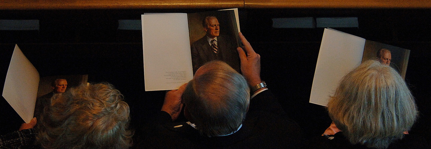 Family guests thumb through the funeral program before members of the Honor Guard carry the Late Former President Gerald R. Ford into the Grace Episcopal Church in Grand Rapids, Michigan for his funeral service on January 3, 2007. (Photo by TSgt. Jeremy T. Lock) | Jeremy Lock Photography