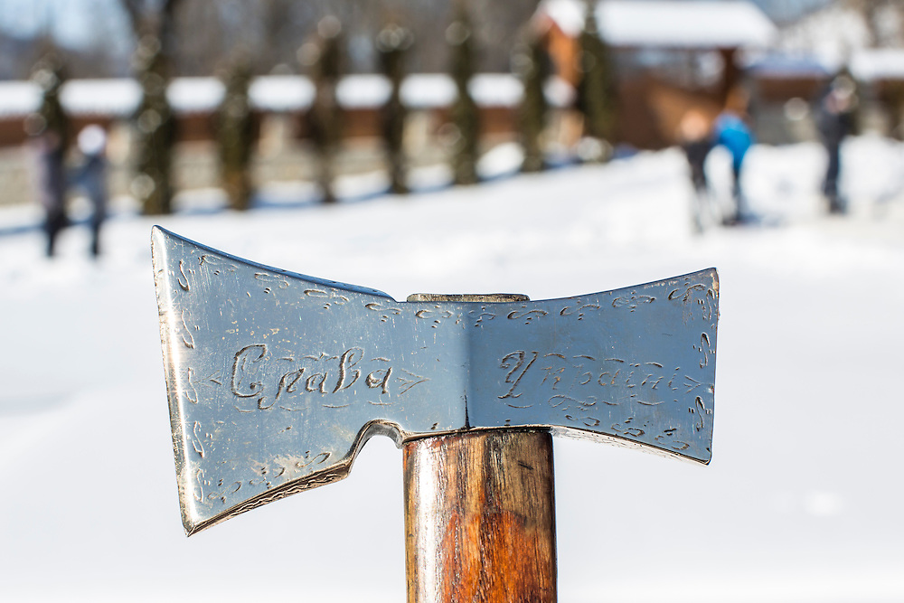 ILTSI, UKRAINE - JANUARY 7: A handmade ceremonial Hutsul axe inscribed with the words Glory to Ukraine is shown by its owner at Holy Trinity Church, where many gathered to celebrate the Orthodox Christmas on January 7, 2015 in Iltsi, Ukraine. The men will gather in groups and travel house to house over the next twelve days singing songs until they've visited every home in the village. (Photo by Brendan Hoffman/Getty Images) *** Local Caption ***