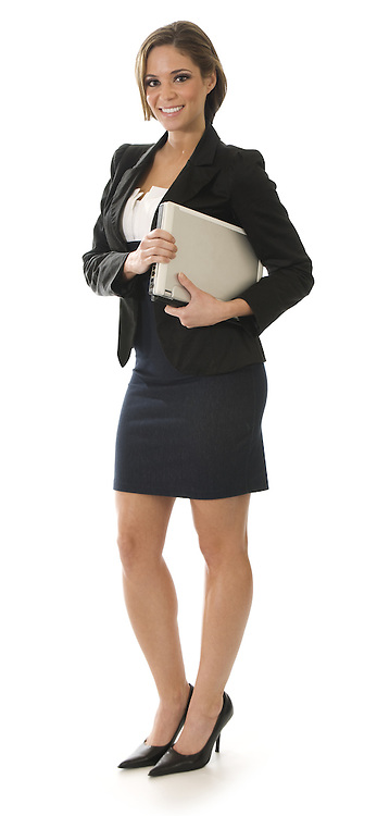 Young attractive professional businesswoman standing on a white background holding a laptop