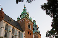 afternoon sunshine filters through trees surrounding krakow's wawel cathedral and castle in september 2005