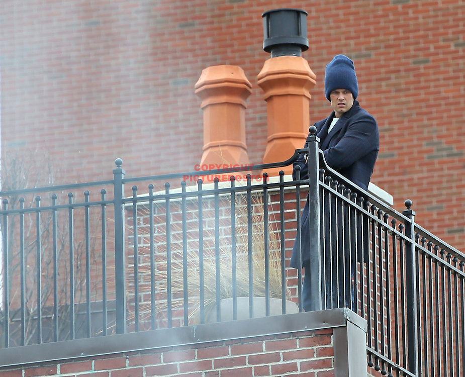 03/26/14-Boston,MA. New England Patriots' quarterback, and Back Bay resident, Tom Brady watches as a 9 alarm fire rips through a home 2 doors down from his home at the 300 block of Beacon St. today, March 26, 2014. A large wind-whipped fire claimed the Back Bay building and injured several today, March 26, 2014. Staff photo by Mark Garfinkel