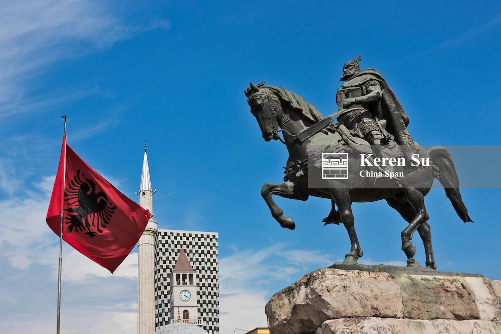 Statue of Skanderbeg, national flag and Coin Shopping Center housing the Italian Department Store in Skanderbeg Square, Tirana, Albania
