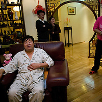 BEIJING, 25. JANUARY, 2009 :   mr. Li, a paper factory owner, takes a rest while his relatives entertainthemselves in his sumptuous apartment on new years' eve.<br /> Mr. Li, a paper factory owner, is facing one of his most difficult times .&quot; Last November the market suddenly went down ,&quot; Li says.   <br /> He had bought paper, a lot of paper, and paid 7000 Yuan/ t .<br />  Li's company buys paper from paper mills and lives from the sales to publishing houses and other companies.  Since the market's collapse , he manages to sell the paper only for 6000 Yuan/t.<br /> His clients' export business to the USA had shrunk in Southern China. Mobile phone manufacturers don't need paper for the instruction guides to their mobile phones anymore as their US clients buys less China- made mobile phones.<br />  Toy manufacturers don't need paper anymore  because Americans import less toys from China. &quot; The crisis has driven many of my clients into bancruptsy&quot;, says Li.<br />  <br /> China's Communist Party  which will celebrate its 60th anniversary in October, currently faces its biggest challenge since the beginning of the economic reforms 30 years ago  : &quot; The phase of  rapid economic growth is over. For the first time the government is threatened with a  mistrust of a wide section of the population&quot;, warns the Communist party's Shang Dewen in Beijing.   <br /> Not only the China's poorest worry about the furture, but as well China's middle class is concerned about the crisis.     1,5 Millionen university graduates didn't find a job until the end of 2008  and this summer there'll be an additional  6,1 Million new graduates. More than 12 percent of university graduates face unemployment in 2009.