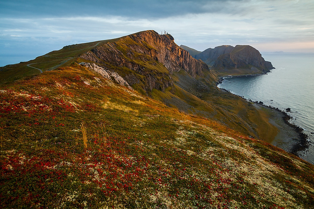 The crest of Vaeroy Island at sunset, Lofoten Islands, Norway. The North Atlantic Treaty Organization (NATO) naval military radar is visible on a distant ridge.