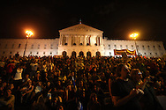 Thousands gather in front of the Portuguese parliament, in the background, in Lisbon listening to speeches during a popular assembly Saturday, Oct. 15 2011. After a protest march, demonstrators held an assembly where anyone could have the microphone and express their ideas and proposals to the crowd. Demonstrators marched Saturday in European cities as protests against capitalism and austerity measures went global.