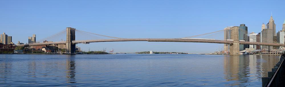 New York City, Brooklyn Bridge with Manhattan, panorama at morning.