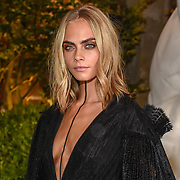Cara Delevingne took the plunge in a very revealing black gown as she stepped out for Burberry's September 2016 presentation.<br /> The Suicide Squad actress and model is no stranger to the runway, and she stunned as she stepped out to attend the huge show during London Fashion Week in the low cut - and rather short - black dress, which was completed with a flowing cape at the back, laced heels and a thin strip of material running all the way from her neck to below her cleavage.