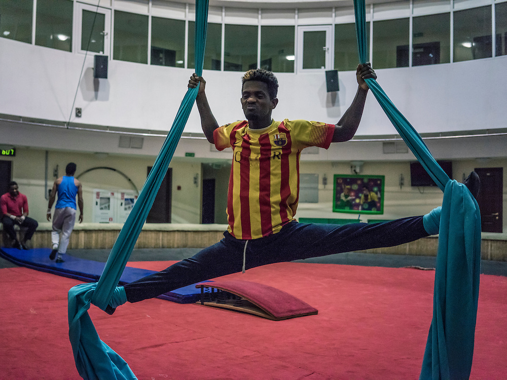 A circus performer from Ethiopia warms up for a rehearsal on Wednesday, November 25, 2015 in Minsk, Belarus.