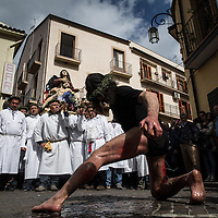A Battente flagellates himself to pay his respect to the statue of the Vergin Mary