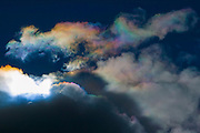 Bright, rainbow-like colors are visible in thin clouds known as iridescent clouds over Bryce Canyon in Utah. Iridescent clouds are relatively rare and appear in clouds formed of small water droplets of nearly uniform size. Commonly, iridescent clouds are near much thicker clouds that partially hide the sun.